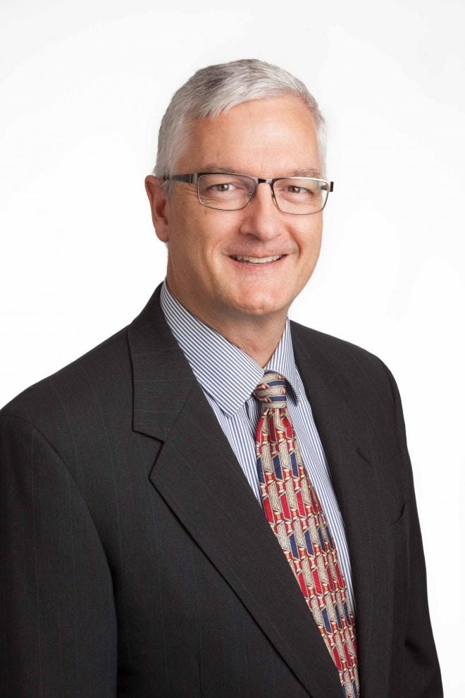 Headshot of John Hicks for SDM.
