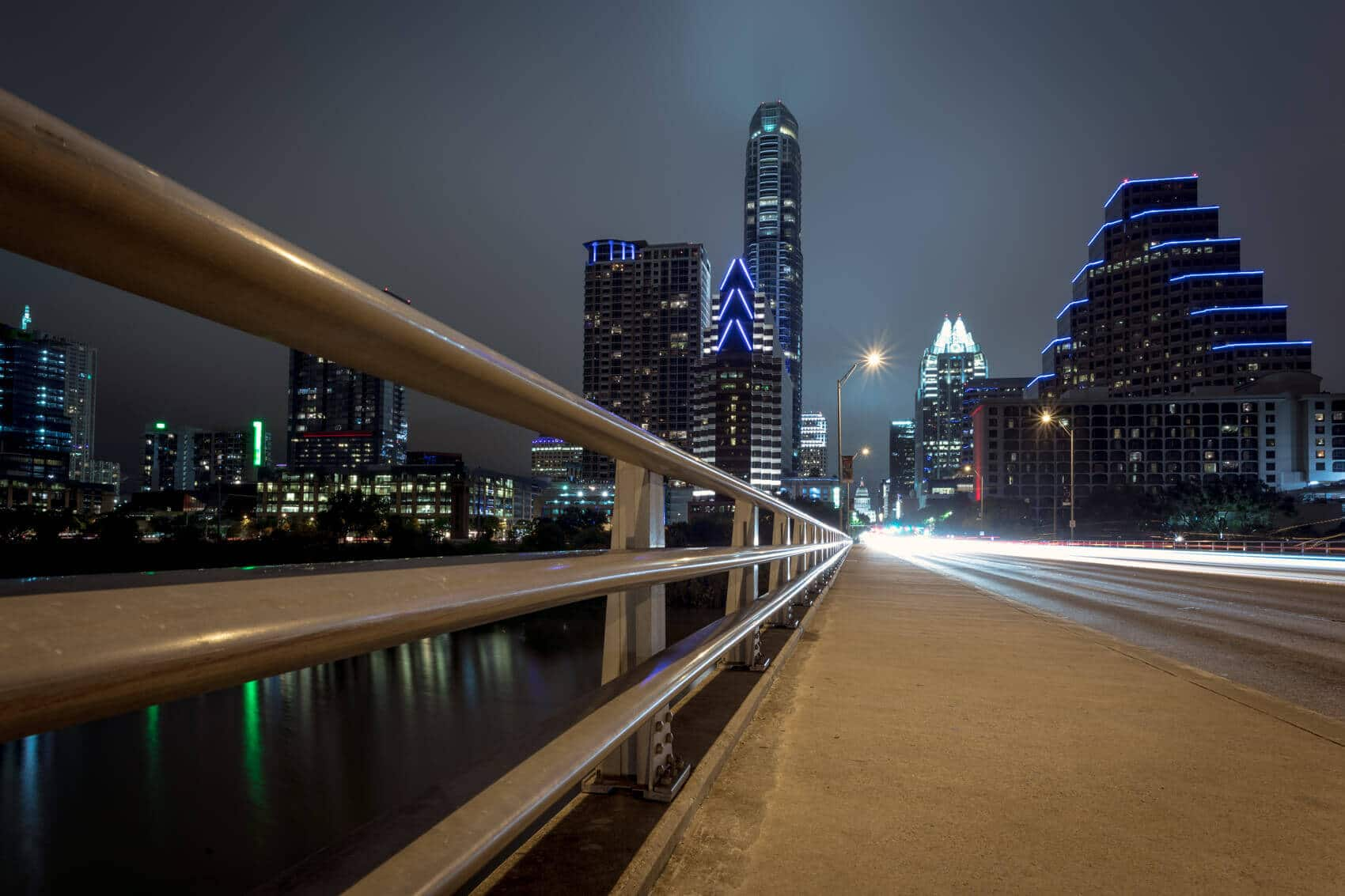Downtown Austin from a pedestrian bridge at night.