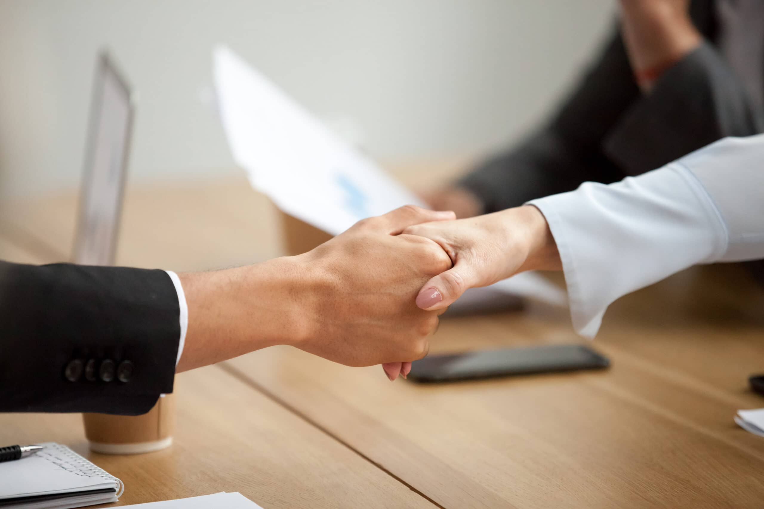 People shaking hands during a meeting.